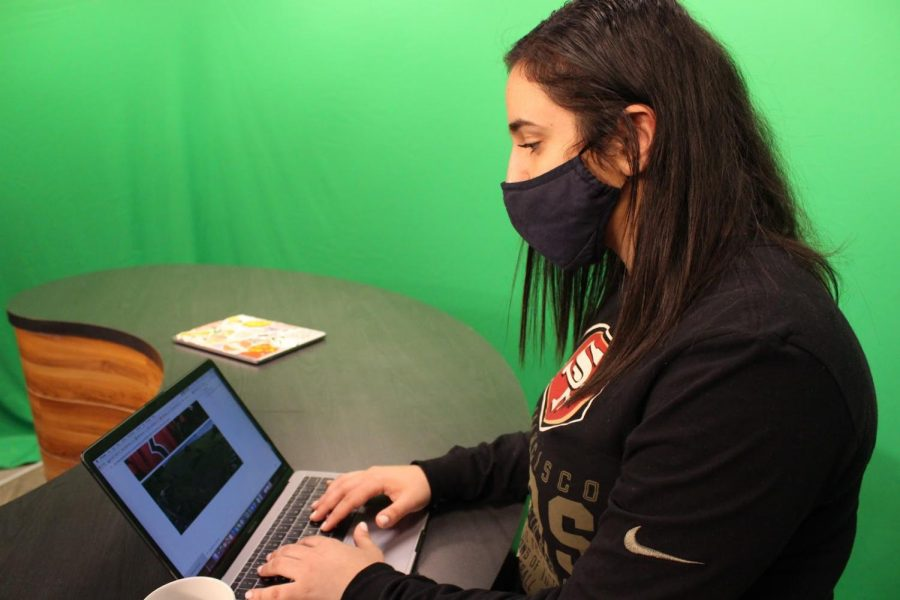 KCBY-TV junior sports director Thea Massi works on an outline for a softball hype video in the KCBY studio on Tuesday. Massi uses KCBY as a way to further explore her love for media and broadcasting.
