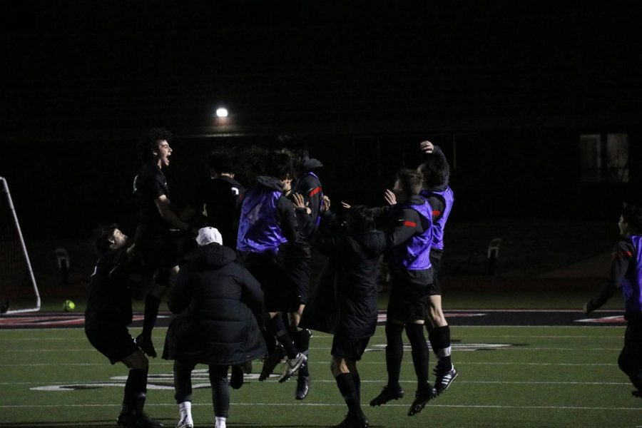 The Coppell soccer team celebrates sophomore forward Preston Taylor's goal that was scored in the first minute against Flower Mound Marcus on Feb. 2 at Buddy Echols Field. The Cowboys defeated Marcus, 2-0.