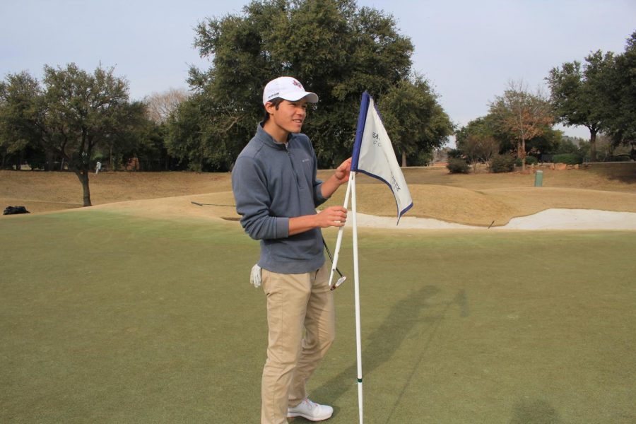 Coppell senior golfer Andrew Chow replaces the flagstick at practice on Thursday at Hackberry Creek Country Club in Irving. Chow's involvement in Young Life and the Young Men's Service League helped him gain the leadership skills to be captain of the golf team.