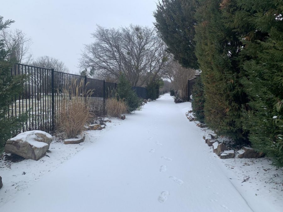 The back alley of Leisure Lane is covered in snow on Sunday. Coppell High School administrators are supporting students and faculty through the power outages caused by the freezing temperatures.