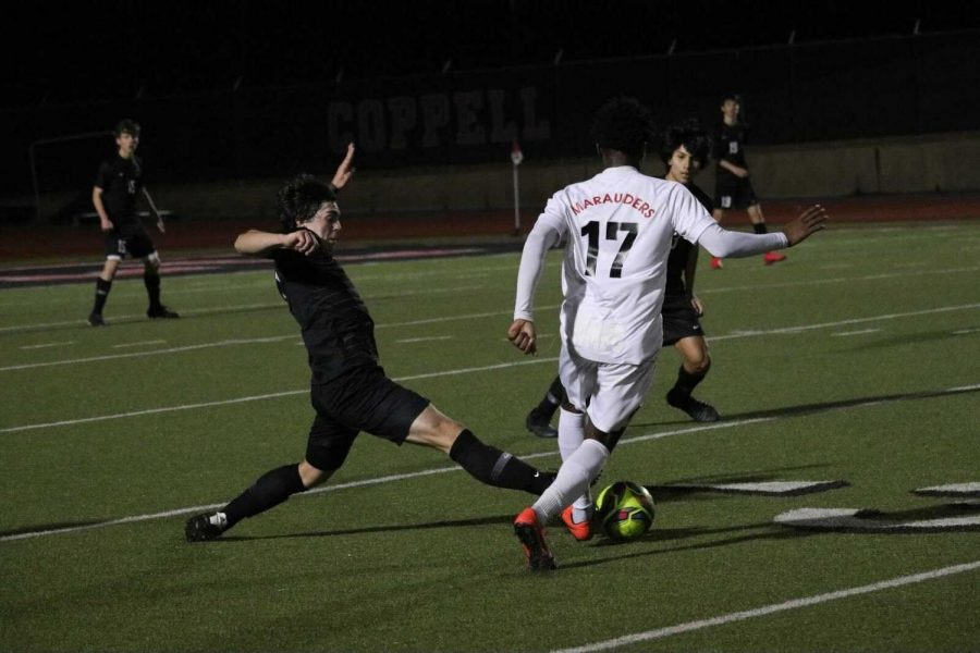 Coppell senior defender Garret Greaves defends blocks an oncoming opponent on Tuesday at Buddy Echols Field against Flower Mound Marcus. The Cowboys host Lewisville tomorrow at Buddy Echols Field with kickoff at 7:30 p.m.