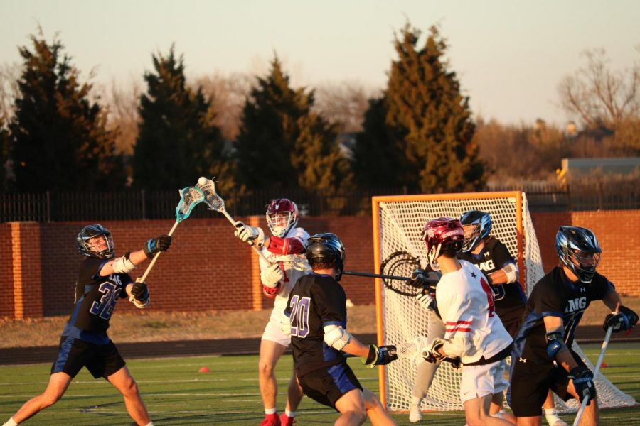 Coppell senior midfielder Jacob Dashner fights IMG National for possession at the Coppell Middle School North field on Wednesday. Coppell lost, 19-6.