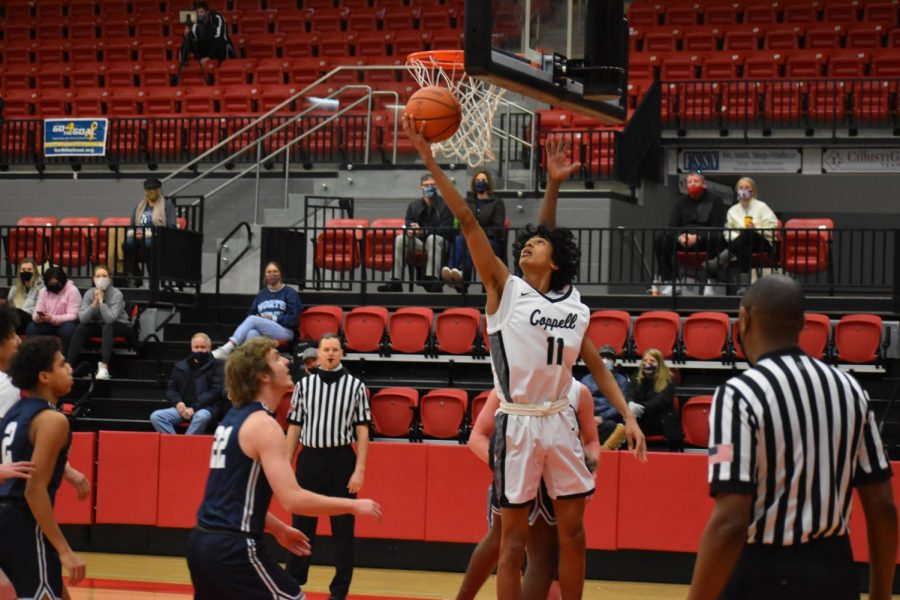 Coppell junior shooting guard Ryan Agarwal takes a layup against Flower Mound Saturday at the CHS arena. Coppell defeated Flower Mound, 52-39. Photo by Nick Larry