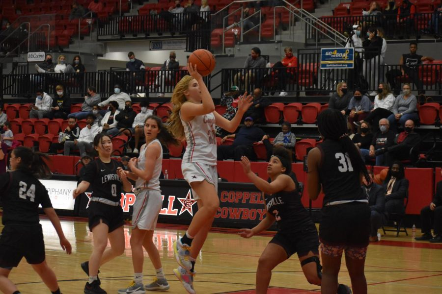 Coppell sophomore power forward Julianna  Lamendola takes a shot against Lewisville at the CHS arena on Friday night. The Cowgirls were defeated by Lewisville with a close score of 32-29.