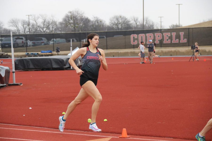Coppell senior runner Chloe Hassman competes in the women's 3200 meter run at Buddy Echols Field in Saturday's Coppell Relays. Hassman broke her personal record with a time of 11:08.36.