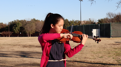Coppell High School junior Jessica Liang plays her violin at Cimarron Park on Jan. 25. Liang is a part of the string quartet of the Chamber Music International Youth Ambassadors Organization.