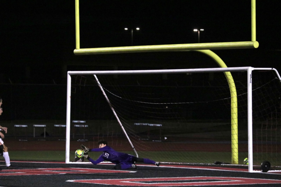 Coppell freshman goalkeeper Jacob Campbell saves a header from Marcus junior defender Woody Pondeca after a Marcus corner kick on Tuesday at Buddy Echols Field. The Coppell boys soccer team defeated Flower Mound, 2-0, in District 6-6A play.