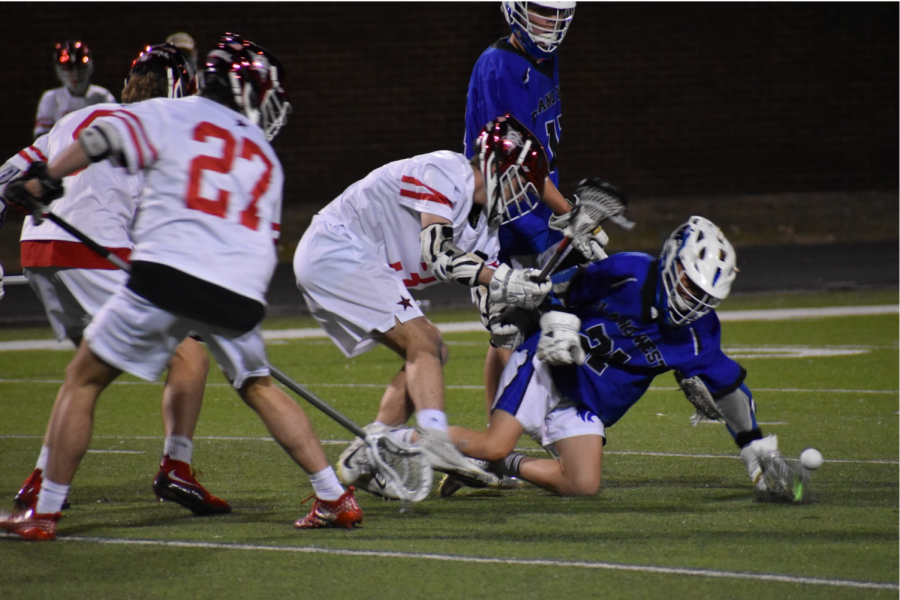 Coppell junior midfielder Nick Rogers and Coppell sophomore defender Blake Robbins go after the ball. The Cowboys secured the win in its season opener on Monday night against Plano West, 16-6.