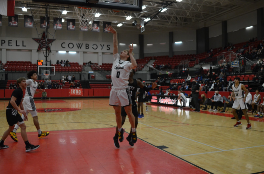 Coppell senior guard Benjamin Klements shoots against Plano West at the CHS Arena last night. The Cowboys defeated Plano West, 58-42, defending their position as first in District 6-6A.