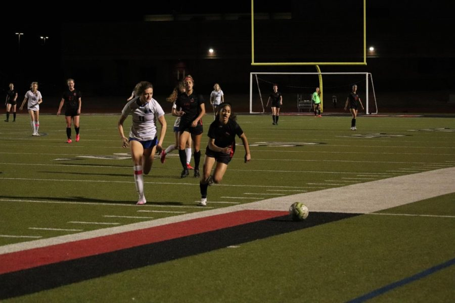 Coppell sophomore middle Saiya Patel runs against Plano West senior middle Karsen Aguirre at Buddy Echols field on Tuesday. Patel is a dual sport athlete who plays on the Coppell soccer and basketball team.