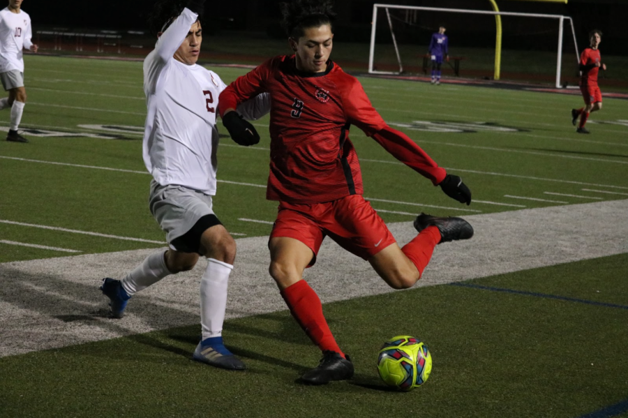 Coppell sophomore forward Preston Taylor kicks against Lewisville on Tuesday at the Buddy Echols Field. The Cowboys defeated the Farmers, 3-0.