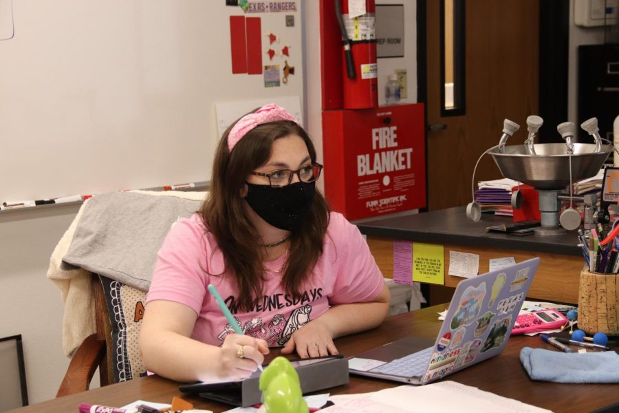 Coppell High School AP and honors chemistry teacher Courtney Crosby teaches a lesson on solubility during her second period class on Wednesday. Crosby has been selected for The Sidekick teacher of the week and has taught at CHS for two years.
