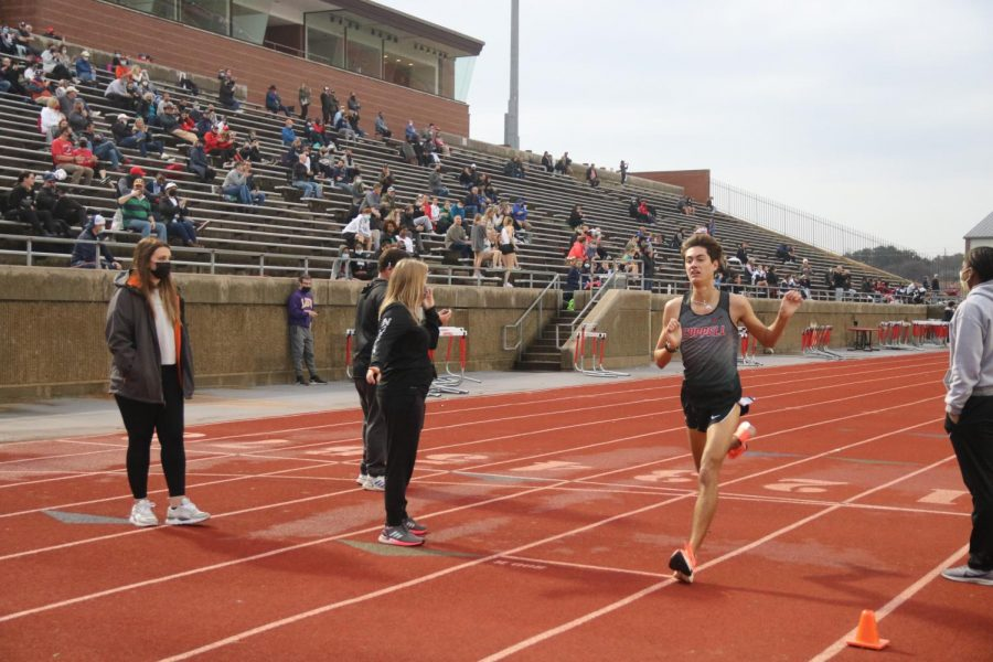 Coppell senior runner Evan Caswell completes his final lap of the 3,200-meter run at Buddy Echols Field in Saturday's Coppell Relays. Caswell placed first with a new school record of 9:12.27, leading the Cowboys to place third overall. Photo by Olivia Cooper