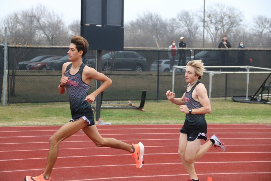Coppell senior runner Evan Caswell and sophomore runner Andrew Mullen make strides in the 1600-meter run at Buddy Echols Field in Saturday's Coppell Relays. Caswell finished first with a new personal record of 4:22.55, contributing to the Cowboys placing third overall.Photo by Olivia Cooper
