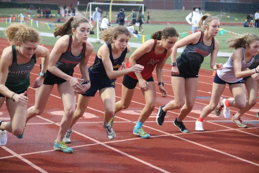 The Coppell 3,200-meter race begins at Buddy Echols Field during Saturday's Coppell Relays. Coppell senior runner Chloe Hassman placed first in the 3,200-meter run, with a personal record of 11:08.36. Photo by Olivia Cooper