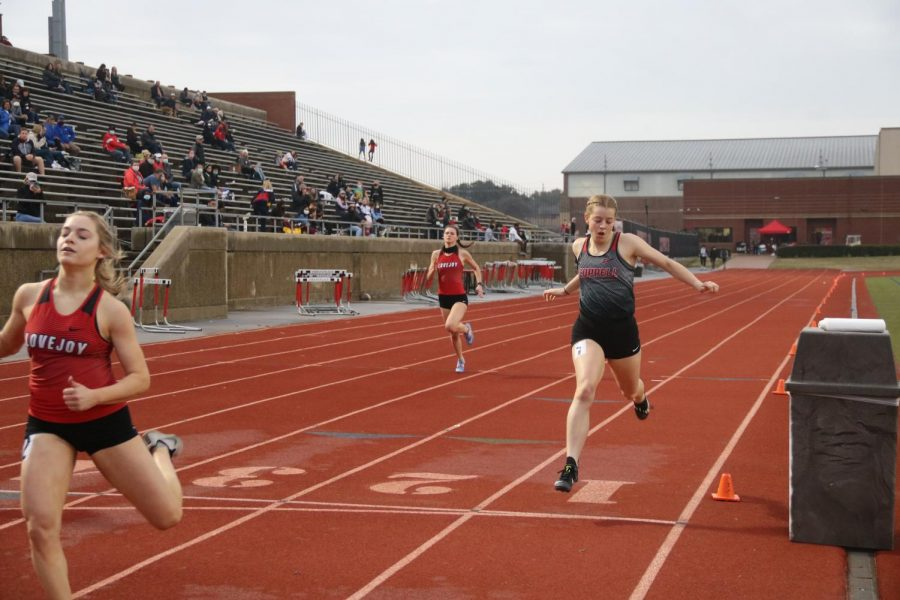 Coppell senior runner Emma Sherrer crosses the finish line for the 400-meter run at Buddy Echols Field in Saturday's Coppell Relays. Sherrer finished with a time of 1:01.37, placing fourth. Photo by Olivia Cooper
