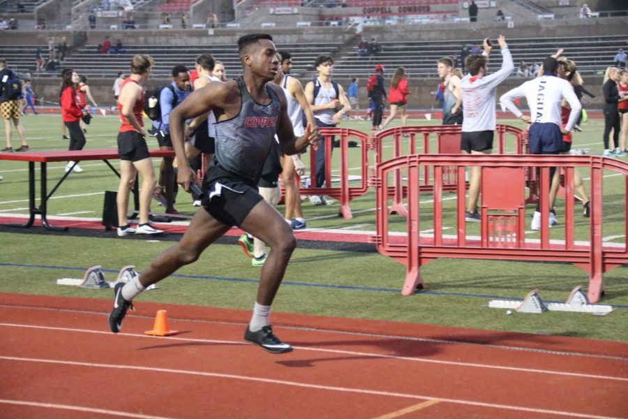 Coppell senior runner Geoffrey William begins his leg of the 1,600-meter relay at Buddy Echols Field during Saturday's Coppell Relays. The Cowboys finished seventh in 1,600-meter relay and third overall. Photo by Olivia Cooper