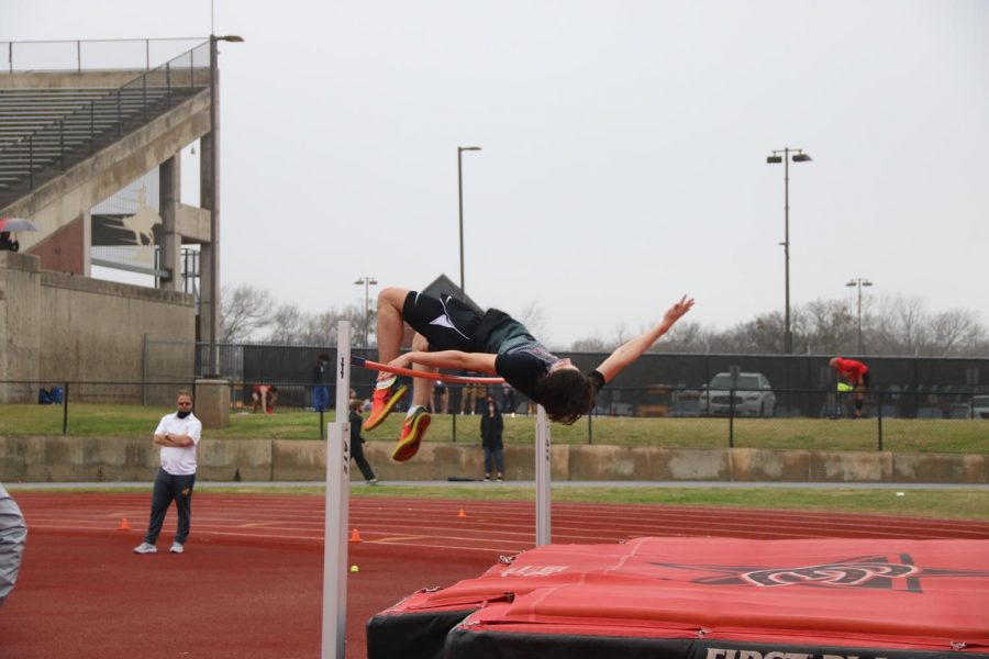 Coppell sophomore Mathew Saucedo high jumps at Buddy Echols Field on Saturday. Saucedo placed third, helping the Cowboys finish third overall. Photo by Olivia Cooper