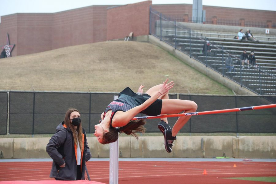Coppell sophomore Skylar Schuller high jumps at Buddy Echols Field on Saturday. Schuller placed first in the high jump, helping the Cowgirls finish second overall. Photo by Olivia Cooper