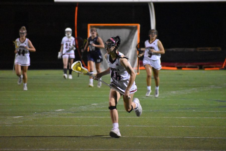 Coppell junior Haley Wenzel cradles against Keller at the Coppell Middle School North field on Thursday. Keller won, 17-16, despite Coppell's second half surge.
