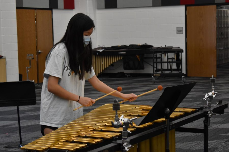 Coppell High School senior Yiwei Shen plays the vibraphone during percussion practice in the band hall on Monday. Shen receives Student of the Week for being in the top five percent while using her work ethic and creativity.