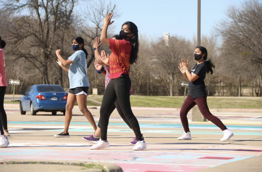 """Coppell High School sophomore Mihira Kada rehearses her Vivace! performance """"Home"""" by Philip Philips at the CHS parking lot on Sunday. Kada was named co-captain of Vivace! early second semester."""