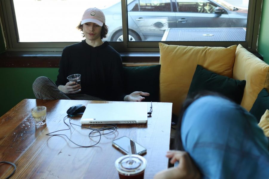 New Tech High @ Coppell senior Cole Ramirez sips on a cortado while talking to The Sidekick co-sports editor Anjali Krishna at Golden Boy Coffee on Feb. 20. Ramirez has a niche for coffee and the power it has to bring people together by forming its own culture.