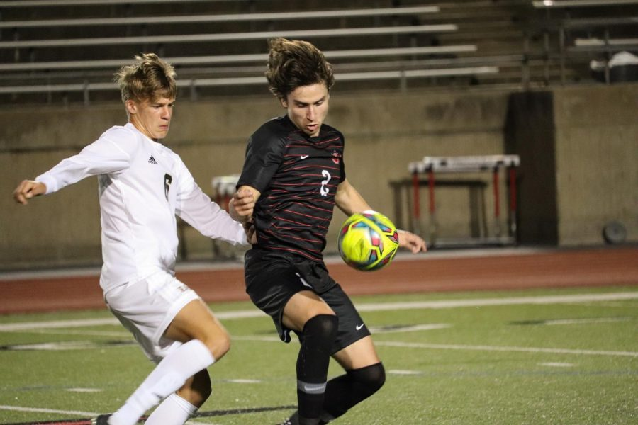 Coppell senior forward Brandon Gast shields against Plano East junior defender Luke Mulkey at Buddy Echols Field on March 9. The Cowboys face Prosper tomorrow in the Class 6A bi-district playoffs at Denton High School, with kickoff at 7:30 p.m.
