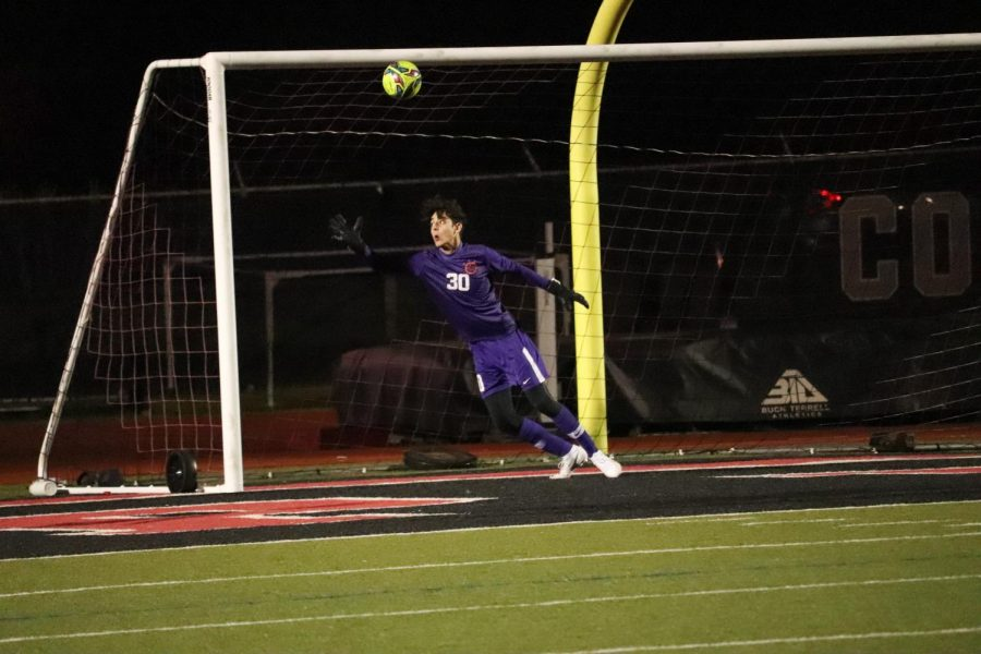 Coppell freshman goalkeeper Jacob Campbell blocks against an incoming Plano East shot at Buddy Echols Field on Tuesday. The goal resulted in the Cowboys tying against the Panthers, 2-2.