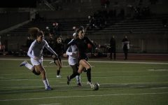 Coppell junior forward Michelle Pak attempts to score against Lewisville defender Averi Culver at Buddy Echols Field on March 5. Coppell plays Prosper in the Class 6A Region I bi-district playoffs tomorrow at McKinney ISD Stadium at 7:30 p.m.