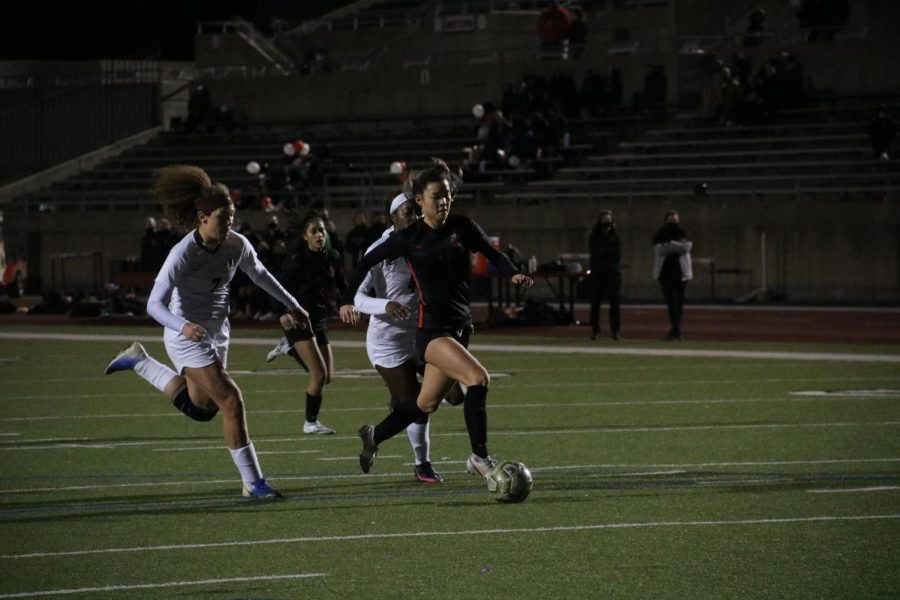 Coppell junior forward Michelle Pak attempts to score against Lewisville defense Averi Culver at Buddy Echols Field on Friday. Coppell won, 4-2.