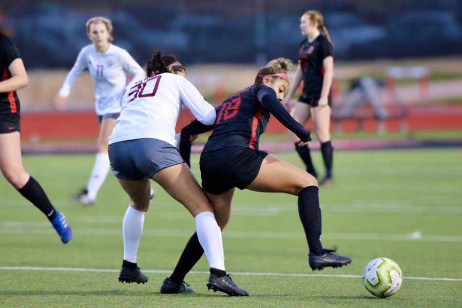 Coppell junior forward Renata Vargas and Plano senior midfielder Natalie Montanez seek possession at Buddy Echols Field on Monday. Coppell plays Lewisville on its Senior Night at 7 p.m. at Buddy Echols Field tonight.