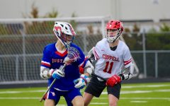 Coppell senior midfielder Graham Wharton defends Grapevine junior midfielder Logan Park Sunday afternoon at Lesley Field. The Cowboys defeated the Mustangs, 17-5.