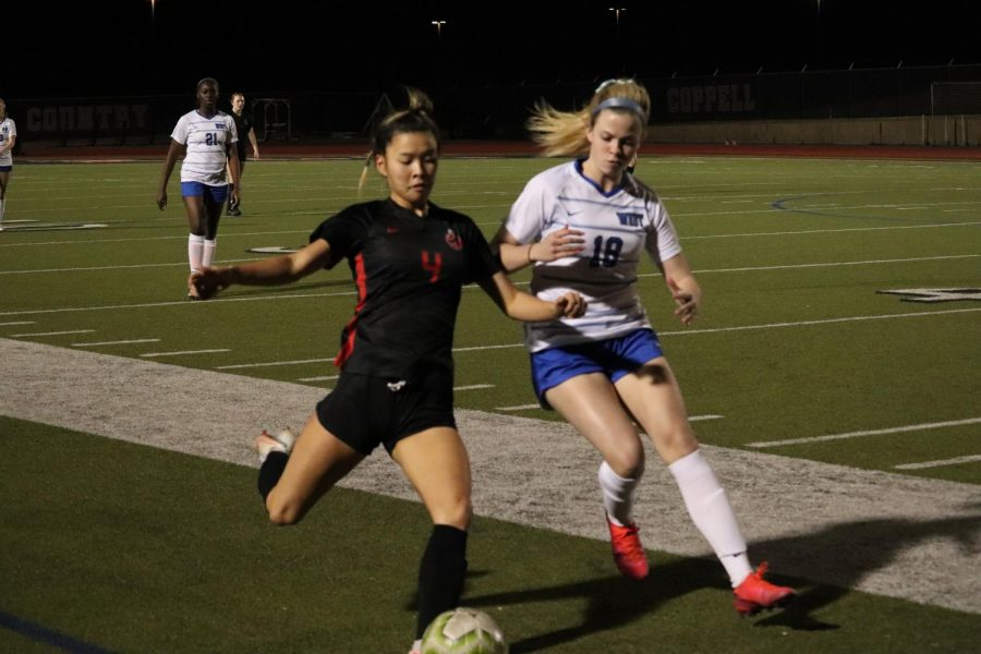 Coppell junior forward middle Michelle Pak passes against Plano West junior middle Morgan Donahue at Buddy Echols Field on Tuesday. Coppell defeated Plano West, 1-0.