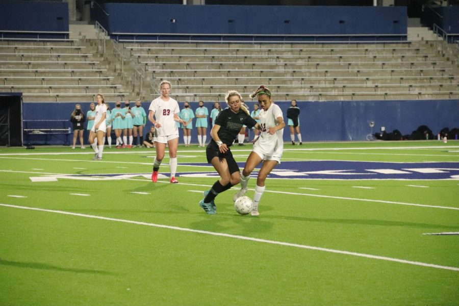 Coppell senior forward Jocelyn Alonzo fights for control against Prosper senior defender Haley Nichols at Mckinney ISD Stadium on Friday. Coppell lost the UIL Bi-District playoff, 2-0.