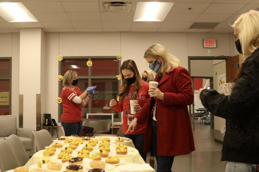 "The CHS9 Sunshine Committee hands out donuts and coffee to faculty as they celebrate national ""I Want You To Be Happy"" day on Wednesday. The Sunshine Committee hosts events every year since 2018 to celebrate major life events and boost the morale of the staff."