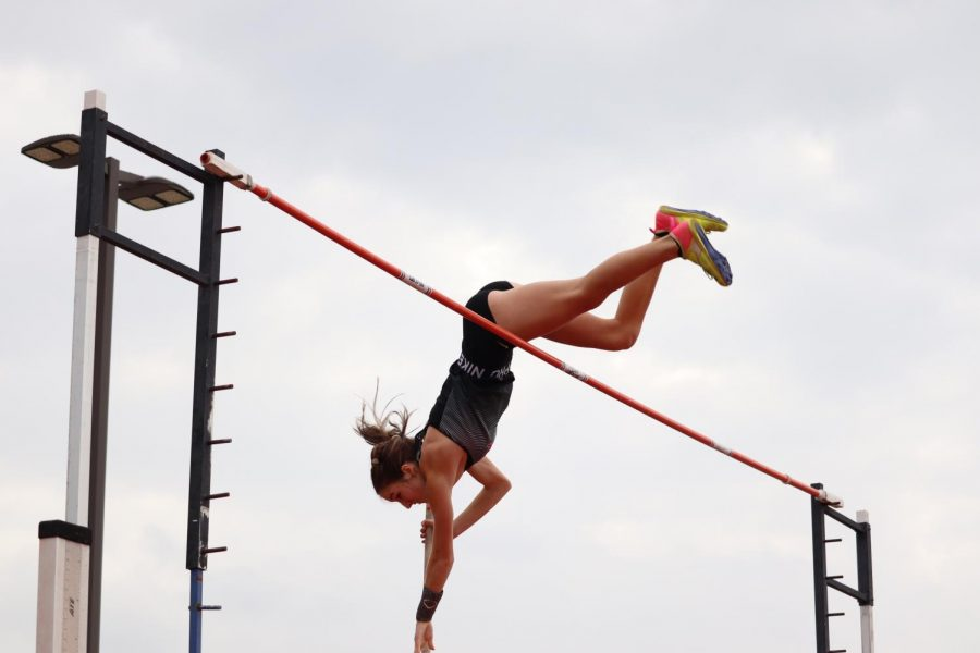 Coppell sophomore vaulter Sky Schuller jumps over the bar in the women's pole vault, placing first while claiming a school and personal record, with a height of 13-06.00. Coppell hosted its Coppell Invitational meet on March 11 at Buddy Echols Field, with the Cowboys taking second overall in the Cowgirls first overall.