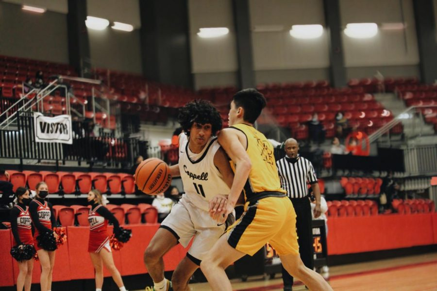 Coppell junior guard Ryan Agarwal drives against Plano East freshman shooting guard Jon Tran at the CHS Arena on Feb. 2. Agarwal announced his commitment to Stanford University, his dream school, on March 16.