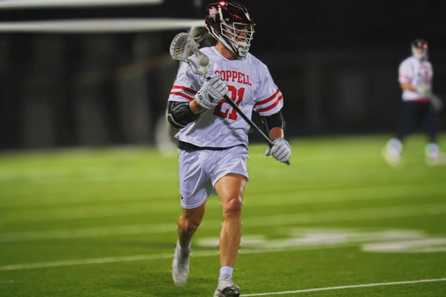Coppell senior midfielder Bain Carter carries to score at Lesley Field on Thursday. Coppell defeated Keller, 11-7.