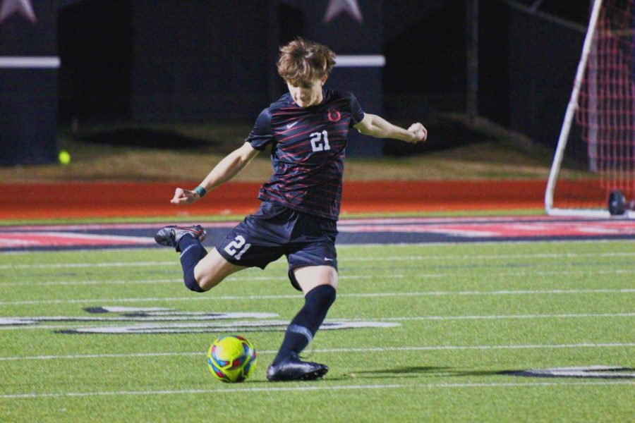 Coppell senior defender Collin Macdonald takes a free kick against Plano at Buddy Echols Field on Tuesday. Coppell defeated Hebron, 5-0.