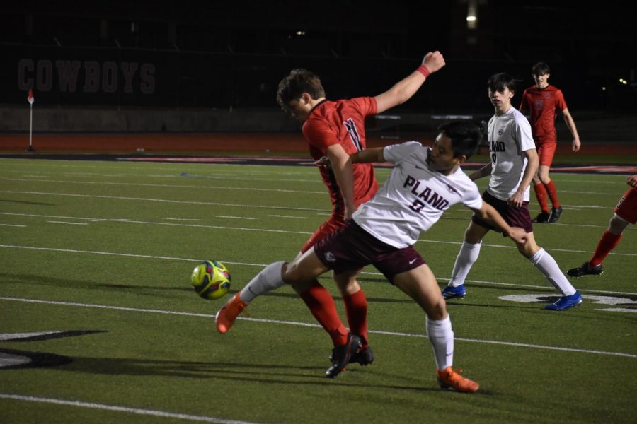 Coppell sophomore forward Nic Radicic fights Plano senior midfielder Jonathan Cui for possession at Buddy Echols Field on Monday. The Cowboys defeated Plano, 2-1.