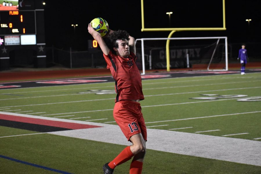 Coppell senior defender Daniel Nelson throws in against Plano at Buddy Echols Field on Monday. The Cowboys defeated Plano, 2-1.