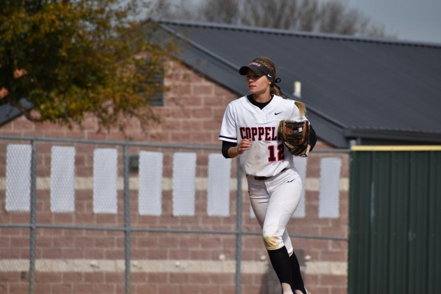 Coppell senior shortstop Sydney Ingle returns to the dugout between innings against Cedar Hill on March 7, 2020 at the Coppell ISD Softball Complex. The Cowgirls won all four games of the 2021 Coppell & Marcus Tournament from Thursday to Saturday.