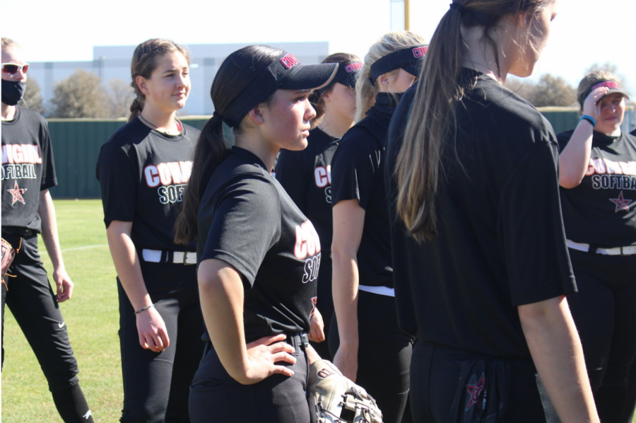 Coppell senior catcher Dafne Mercado and her teammates huddle after practice at the Coppell Softball Complex on Wednesday. Mercado has played softball since she was 8 and is trying out for the Mexican Olympic team over the summer.