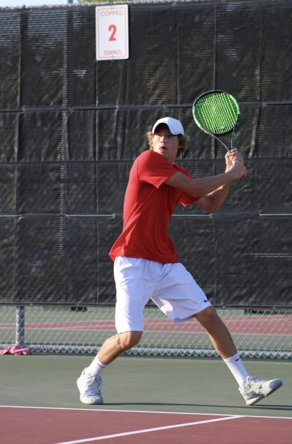 New Tech High @ Coppell junior Cason Cole hits a backhand during his doubles match against Plano East on Sept. 25 at the CHS Tennis Center. Cole and Bellubi have been friends since elementary school and doubles partners for 11 years.
