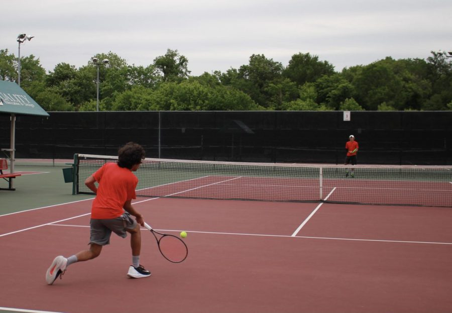 Coppell junior Siddarth Bellubbi rallies with New Tech High @ Coppell junior Cason Cole during practice on April 22 at the CHS Tennis Center. Cole and Bellubi have been friends since elementary school and doubles partners for 11 years.