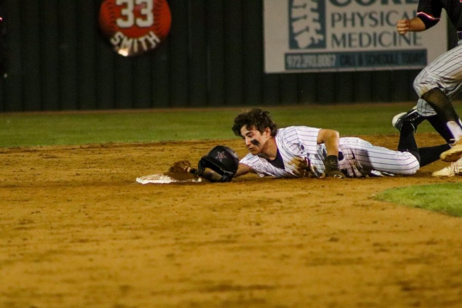 Coppell junior pinch runner Charlie Barker slides into second base. The Cowboys defeated Marcus on Tuesday, 5-2, at the Coppell ISD Baseball/Softball Complex.