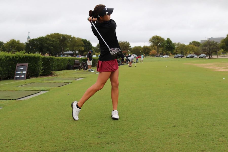 Coppell senior golfer Chelsea Romas finishes a swing on Sept. 23. The Coppell girls varsity golf team won first place at the Class 6A Region I Tournament to advance to the state tournament.