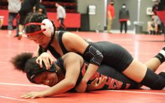 Coppell junior Kylie Fowler competes in the annual Santa Slam Meet at the Coppell High School Arena. The Coppell girls wrestling team placed second in the UIL Region II Championships on April 6 and will compete in Houston tomorrow.