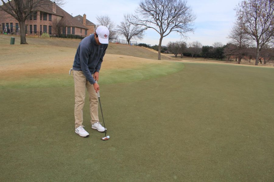 Coppell senior golfer Andrew Chow practices his putting on Jan. 31 at Hackberry Creek Country Club in Irving. The Coppell boys varsity golf team won second place at the District 6-6A Tournament and advanced to regionals.
